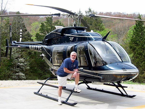 Charlie Duchek with Bell 407 helicopter