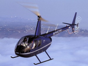 air-to-air aerial photo of Robinson model R44 helicopter